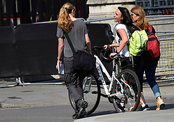 © Licensed to London News Pictures. 14/08/2018. LONDON, UK. A bicycle retrieved for the owner after riders were knocked down during a car crash incident outside the Houses of Parliament.  It is reported that two people were taken to hospital with non life threatening injuries.  A man has been arrested and investigations are ongoing.  Photo credit: Stephen Chung/LNP