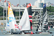 Rounding the top mark, SAP, Alinghi and Emirates Team New Zealand. Day three of the Extreme Sailing Series regatta being sailed in Singapore. 22/2/2014