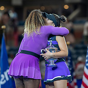 2019 US Open Tennis Tournament- Day Thirteen.    Bianca Andreescu of Canada with the winners trophy and Serena Williams of the United States hug after the trophy presentation after the Women's Singles Final on Arthur Ashe Stadium during the 2019 US Open Tennis Tournament at the USTA Billie Jean King National Tennis Center on September 7th, 2019 in Flushing, Queens, New York City.  (Photo by Tim Clayton/Corbis via Getty Images)