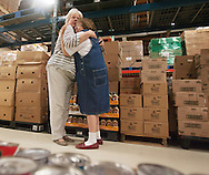 Krista Stone, left, embraces Linda Clark at a retirement open house Monday, June 30, 2014, in recognition of Clark's 14 years of service to the Emergency Food Pantry in Fargo, N.D. <br /> Nick Wagner / The Forum