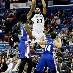 Dec 8, 2016; New Orleans, LA, USA;  New Orleans Pelicans forward Anthony Davis (23) shoots over Philadelphia 76ers center Joel Embiid (21)  and  guard Sergio Rodriguez (14)during the second half of a game at the Smoothie King Center.  The 76ers defeated the Pelicans 99-88. Mandatory Credit: Derick E. Hingle-USA TODAY Sports