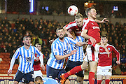 Barnsley defender Marc Roberts (4) scores a goal to take Barnsley  into a 1-0 lead during the Sky Bet League 1 match between Barnsley and Coventry City at Oakwell, Barnsley, England on 1 March 2016. Photo by Simon Davies.