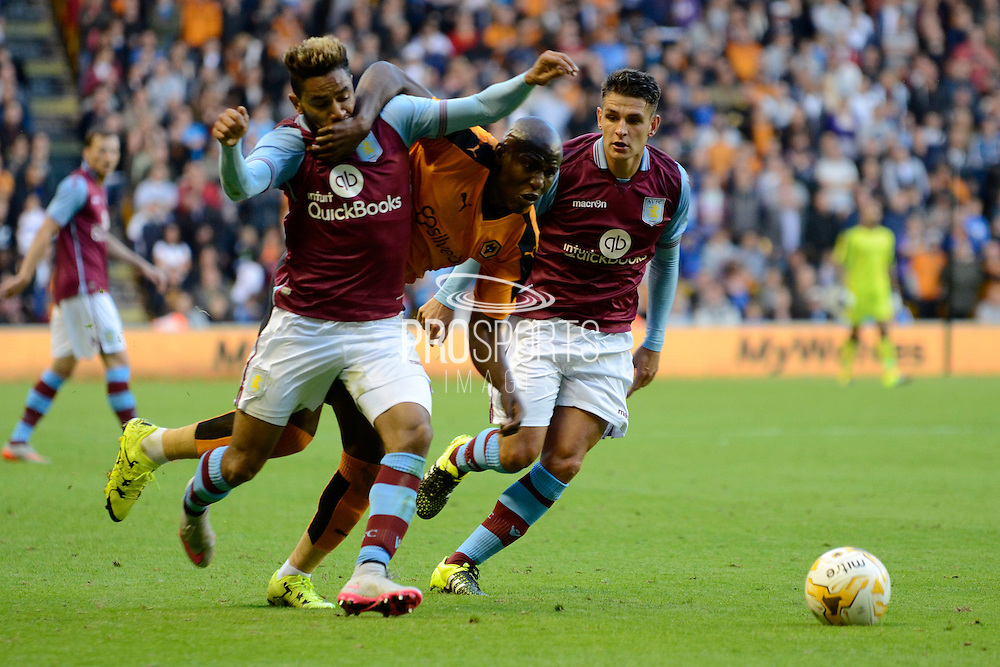 Benik Afobe battles with Jordan Amavi and Ashley Westwood during the Pre-Season Friendly match between Wolverhampton Wanderers and Aston Villa at Molineux, Wolverhampton, England on 28 July 2015. Photo by Alan Franklin.