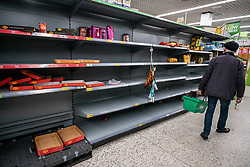 © Licensed to London News Pictures. 05/03/2020. London, UK. Empty shelves on the rice aisle. Panic-buying continues to show in ASDA in South West London as shelves empty out of goods. Prime Minister Boris Johnson appeared on This Morning TV show to reassure the public that the Government is doing all it can to fight the coronavirus disease.. Photo credit: Alex Lentati/LNP