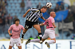 German Gustavo Denis of Udinese vs Giulio Migliaccio of Palermo  during football match between Udinese Calcio and Palermo in 8th Round of Italian Seria A league, on October 24, 2010 at Stadium Friuli, Udine, Italy.  Udinese defeated Palermo 2 - 1. (Photo By Vid Ponikvar / Sportida.com)