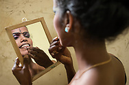 Sri Lanka - Kandyan Dancer putting on makeup preparations for dance