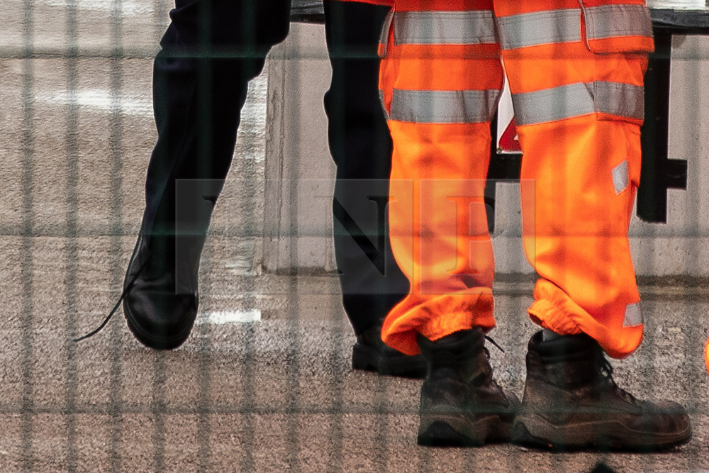 © Licensed to London News Pictures. 27/07/2019. Manchester, UK. British Prime Minister BORIS JOHNSON (pictured with an untied shoelace) visits an under construction area of the Trafford Line extension by Manchester's Pomona Metrolink tram stop during a visit to the city . Johnson will re-announce the HS3 rail link between Manchester and Leeds at a speech in Manchester City Centre today . Photo credit: Joel Goodman/LNP