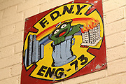 26 February 2013. Bronx, New York. Engine Co. 73/Hook & Ladder 42 at 655-659 and 661 Prospect Ave., the Bronx. Engine Co. 73's mascot is Oscar the Grouch, representing the company's alleged sloppiness. This logo can be seen on the station's wall, door and fire engine. 2/26/13. Photograph by Nathan Place/CUNY Journalism Photo.