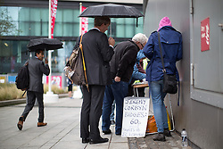 © Licensed to London News Pictures . 27/09/2016 . Liverpool , UK . A stall selling Jeremy Corbyn badges outside the conference centre during the third day of the Labour Party Conference at the ACC Liverpool . Photo credit : Joel Goodman/LNP