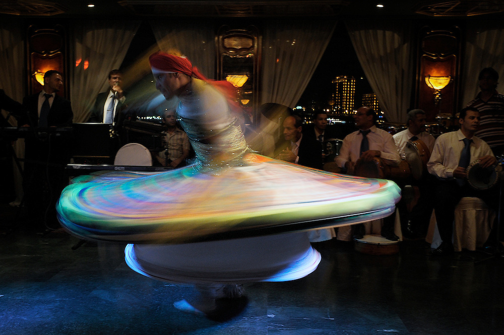 "A non identified ""Suffi"" dancer performing in ""Nile Maxim"" boat and restaurant. Cairo, Egypt."