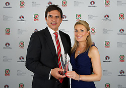 CARDIFF, WALES - Monday, October 5, 2015: ATPI Sports Events representative Kate Suddards presents Wales' Manager Chris Colemen with his Media Choice Award during the FAW Awards Dinner at Cardiff City Hall. (Pic by Ian Cook/Propaganda)