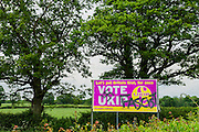 Opinions seen strongly divided near Billingshurst in Sussex over the pros and cons of voting UKIP. Within a few miles there are supporters intraditional 'English' cottages and a farmers supportive sign defaced with grafitti claiming they are facists.