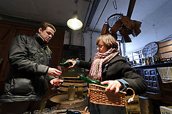 BRUSSELS, BELGIUM - DEC-30-2010 -  Julie Van Roy, right, pours samples of Kriek, and Rose de Gambrinus, which are Lambic beers aged with cherries and raspberries respectively, at the Brasserie Cantillon, a working brewery and museum of Belgian beer history. Cantillon specialises in a unique, wine-like style of beer called Lambic in its most elemental form, and Gueze when it's blended. The sour beer gets its funky, acidic bite from a spontaneous fermentation process and long aging that inoculates the wort, or pre-beer, with bacteria and yeast naturally available in the air. Variations include batches aged with cherries (Kriek), raspberries (Rose de Gambrinus), and apricots (Fou'Foune), all produced organically and all 100 percent Lambic. (Photo © Jock Fistick)