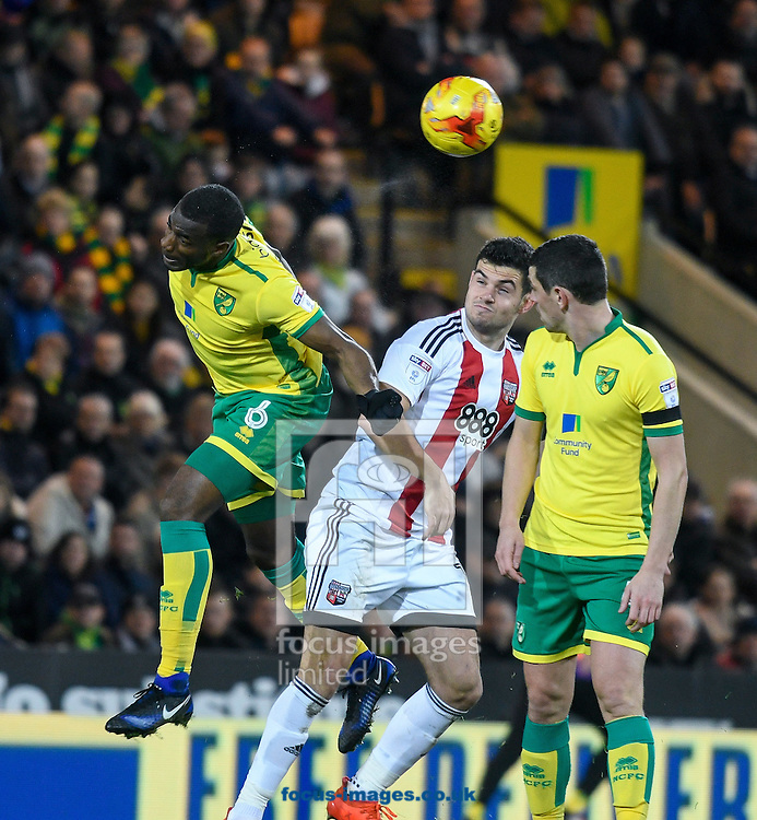 Sebastien Bassong of Norwich City heads the ball against Brentford during the Sky Bet Championship match at Carrow Road, Norwich<br /> Picture by Matthew Usher/Focus Images Ltd +44 7902 242054<br /> 03/12/2016