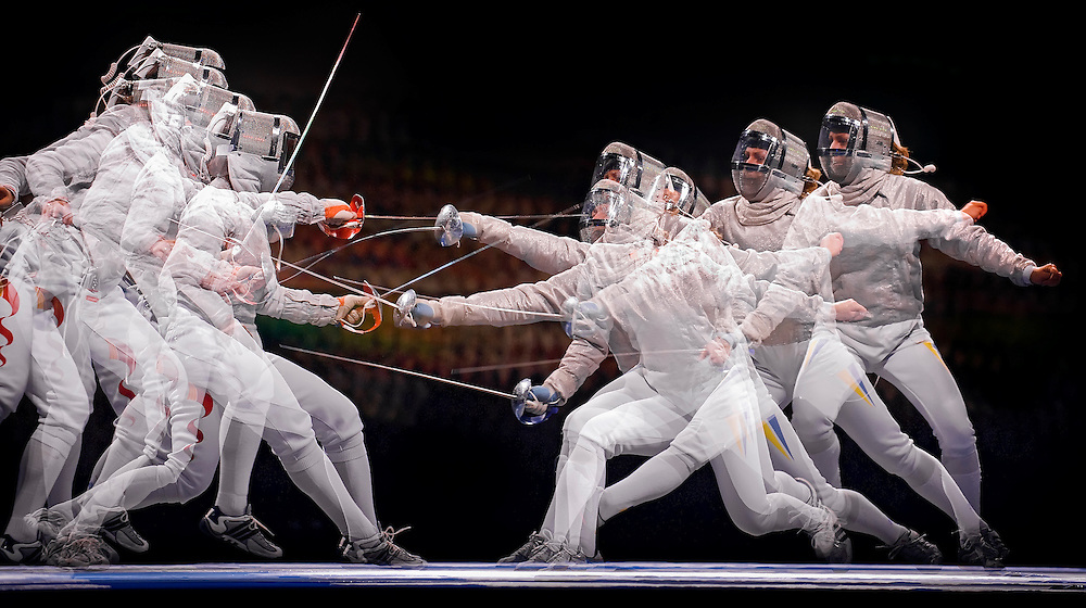 China's Hong Ni, left, and Ukraine's Olga Kharlan, right, duel in a multiple exposure photograph during the women's team sabre at the 2008 Summer Olympic Games in Beijing, China. (photo by David Eulitt / MCT)