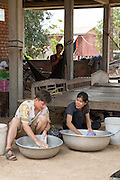 ICS volunteers Dan Hensman & Sokuntheary Nhel hand washing their clothes in the yard of their host home, in the village of in Banteay Char, near Battambang, Cambodia.