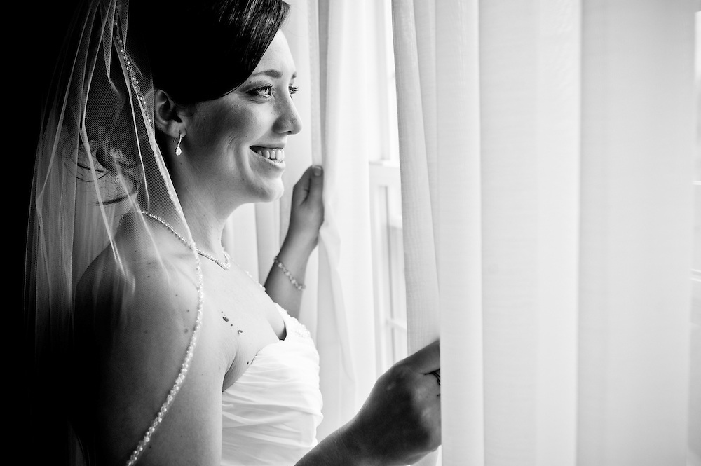 A bride looks out her window.