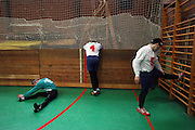 Mitglieder des ungarischen Goalball Teams beim aufwärmen während dem internationalen Turnier in Budapest. Goalball ist eine Mannschaftssportart für blinde und sehbehinderte Menschen und wurde vom Österreicher Hans Lorenzen und dem deutschen Sepp Reindle für Kriegsinvalide entwickelt und zum ersten Mal 1946 gespielt. Die Bilder entstanden auf zwei internationalen Goalball Turnieren in Budapest und Zagreb 2007.<br /> <br /> Members of the hungarian Goalball team during warm up at the international tournament in Budapest. Goalball is a team sport designed for blind and visually impaired athletes. It was devised by an Austrian, Hanz Lorenzen, and a German, Sepp Reindle, in 1946 in an effort to help in the rehabilitation of visually impaired World War II veterans. The International Blind Sports Federatgion (IBSA - www.ibsa.es), responsible for fifteen sports for the blind and partially sighted in total, is the governing body for this sport. The images were made during two Goalball tournaments in Budapest and Zahreb 2007.