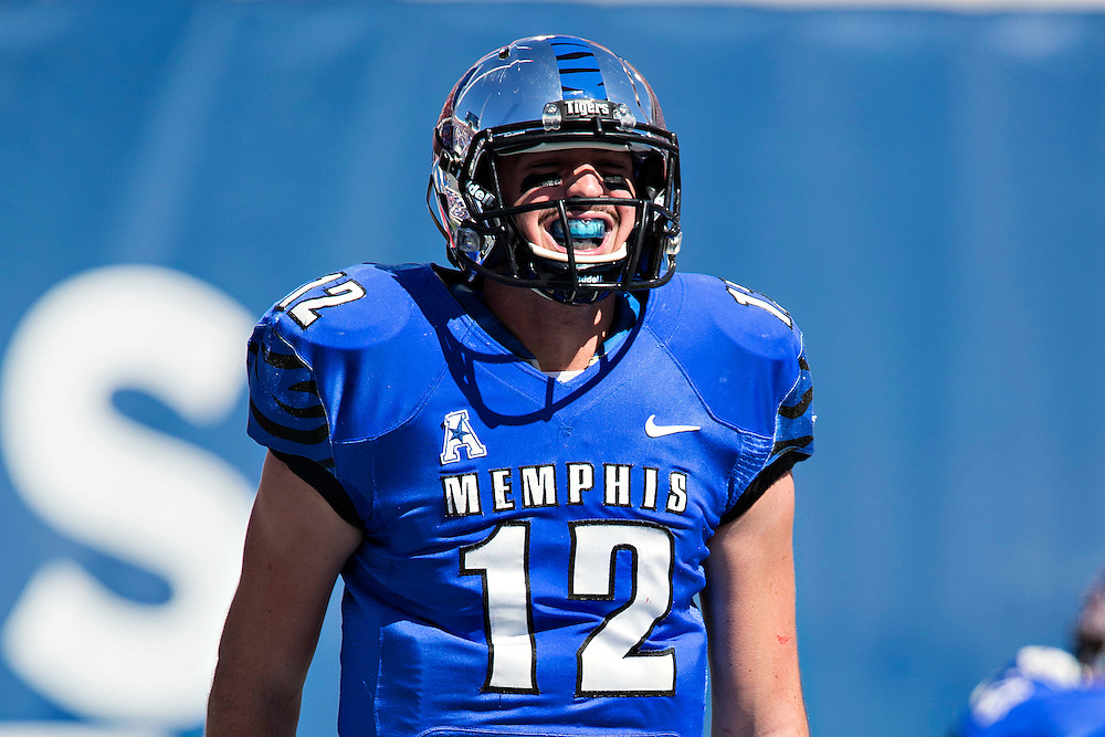 MEMPHIS, TN - OCTOBER 17:  Paxton Lynch #12 of the Memphis Tigers smiles after a touchdown during a game against the Ole Miss Rebels at Liberty Bowl Memorial Stadium on October 17, 2015 in Memphis, Tennessee.  The Tigers defeated the Rebels 37-24.  (Photo by Wesley Hitt/Getty Images) *** Local Caption ***  Paxton Lynch