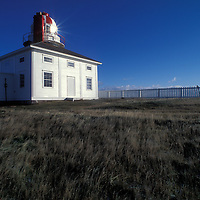 Canada, Newfoundland, Saint Johns, Cape Spear Lighthouse, easternmost point of North America, is lit by winter morning sun