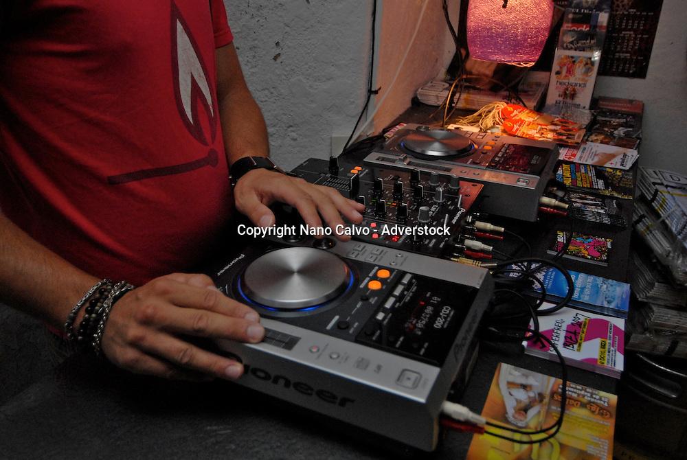 DJ playing inside of Base bar, in La Marina, Ibiza