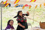 woman spins wool at the Sunday Market at Arreau, Hautes-Pyrénées, France.