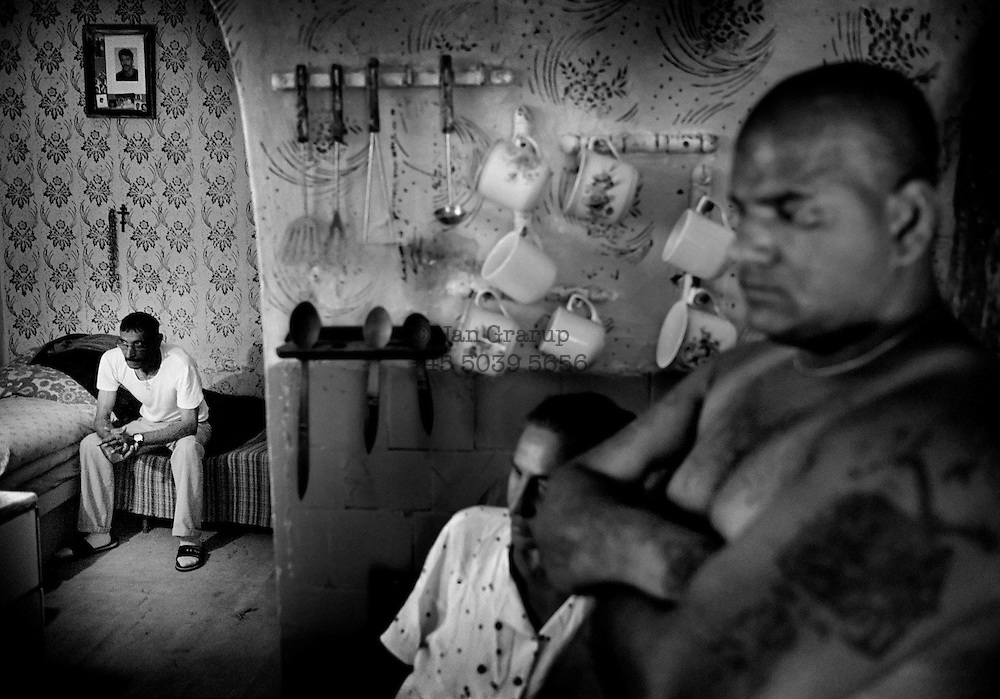 Most of the men in the ghetto are unemployed; they live outside normal society, and many families break up through drink, violence or incest. June 2004.