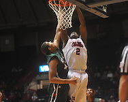 """Ole MIss forward Reginald Buckner (2) dunks over Mississippi Valley State's Jason Holmes (42) at C.M. """"Tad"""" Smith Coliseum in Oxford, Miss. on Monday, December 13, 2010."""
