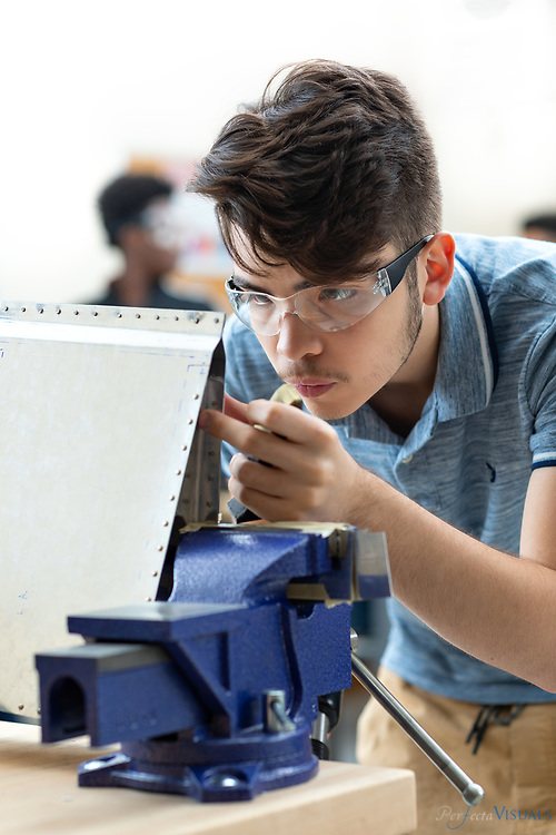 Students rivet ailerons projects made of aluminum sheet metal during an Aviation Academy class at T. Wingate Andrews.<br /> <br /> Photographed, Friday, May 11, 2018, in High Point, N.C. JERRY WOLFORD and SCOTT MUTHERSBAUGH / Perfecta Visuals