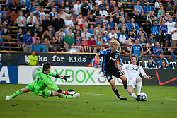 July 20, 2011; Santa Clara, CA, USA;  Vancouver Whitecaps defender Jonathan Leathers (right) stops a break away by San Jose Earthquakes forward Steven Lenhart (center) during the first half at Buck Shaw Stadium.