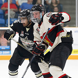 TRENTON, ON - SEP 8:  Gary Dhaliwal #51 of the Trenton Golden Hawks battle for position during the OJHL regular season game between the Newmarket Hurricanes and Trenton Golden Hawks on September 8, 2016 in Trenton, Ontario. (Photo by Amy Deroche/OJHL Images)