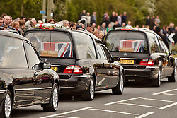 © Licensed to London News Pictures.  17/05/2012. CARTERTON, UK. Friends, family and colleagues pay their respects during a double repatriation ceremony.Corporal Brent McCarthy, of the Royal Air Force Police, and Lance Corporal Lee Davies of 1st Battalion Welsh Guards were killed in Afghanistan May 12 by a man dressed in an Afghan Police uniform.  Photo credit :  Cliff Hide/LNP
