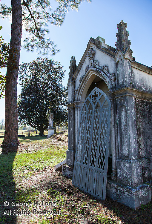 metal door off hinges of tomb in St. Raphael Cemetery along River Road south of Plaquemine, Louisiana