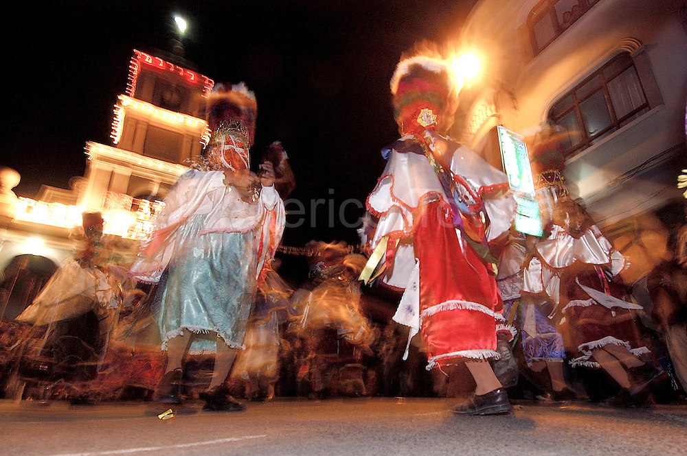 Bolivia. Tarija. Festa di San Roque..Bolivia. Tarija. Festa di San Roque. If the day is dedicated to the procession, in the evening the  Chunchos performing choreography in front of the church.