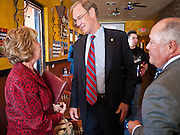 28 OCTOBER 2010 - TOLLESON, AZ: Terry Goddard talks to Sheryl Reese-Edwards (CQ) LEFT and Adolfo Gamez (CQ) right, mayor of Tolleson in Fuego's in Tolleson. Goddard brought his gubernatorial campaign to Fuego's in Tolleson for a lunch time meeting with local voters. Goddard lost the election to sitting Governor Jan Brewer, a conservative Republican.     PHOTO BY JACK KURTZ