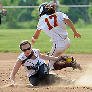 Sheehan at Maloney, Class L softball, quarterfinals: Maloney's Ariele Virgulto makes the out against Sheehan's Mikaeyla Daddio at second. Mara Lavitt/New Haven Register mlavitt@newhavenregister.com<br /> <br /> 5/31/13