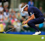 Luke Donald, of England, reacts after missing a birdie putt on the 17th green during the final round of the RBC Heritage golf tournament in Hilton Head Island, S.C., Sunday, April 20, 2014. Matt Kuchar won the tournament with 11-under par. (AP Photo/Stephen B. Morton)