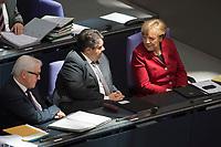 19 MAR 2015, BERLIN/GERMANY:<br /> Frank-Walter Steinmeier (unten), SPD, Bundesaussenminister, Sigmar Gabriel (M), SPD, Bundeswirtschaftsminister, und Angela Merkel (oben), CDU, Bundeskanzlerin, im Gespraech, waehrend der Bundestagsdebatte nach der Abgabe einer Regierungserklaerung durch die Bundeskanzlerin<br /> zum Europaeischen Rat, Plenum, Deutscher Bundestag<br /> IMAGE: 20150319-01-070<br /> KEYWORDS: Gespräch