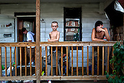Local boys stand on their front porch. They live in the eastern part of Franklinton, which is mostly comprised of abandoned  warehouses. The city of Columbus is focusing its efforts on converting this part of the neighborhood into an artist district with studios, bars and restaurants.