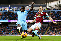 Stephen Ward of Burnley crosses under pressure from Bacary Sagna of Manchester City - Mandatory by-line: Matt McNulty/JMP - 02/01/2017 - FOOTBALL - Etihad Stadium - Manchester, England - Manchester City v Burnley - Premier League