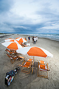 Trademark orange and white umbrellas and a small bonfire on the beach at Cinnamon Shore on Oct 8, 2015. Cinnamon Shore is a pedestrian-friendly planned community located on Mustang Island just off the coast of Corpus Christi and nestled behind 300 feet of protective dunes. (Photo By Tim Burdick)