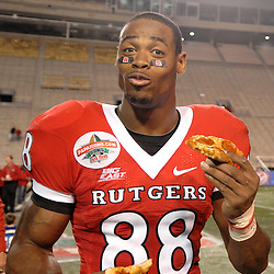 Dec. 29, 2008; Birmingham, AL, USA; Rutgers wide receiver Kenny Britt celebrates the Rutgers Scarlet Knights victory over the N.C. State Wolfpack 29-23 in the Papajohns.com Bowl at Legion Field.