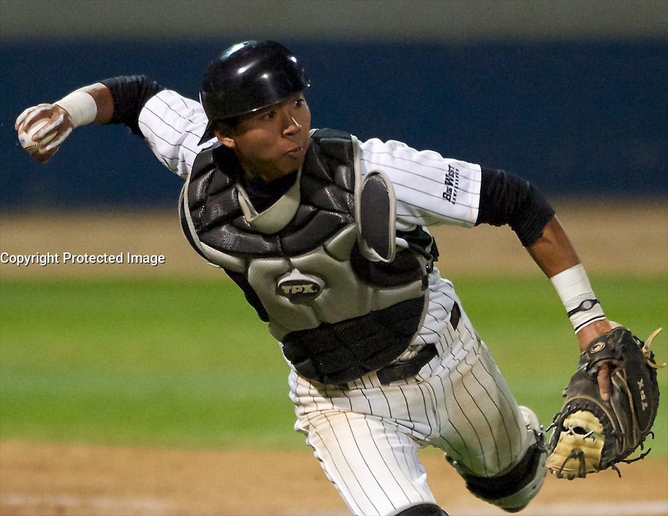 Royce Murai throws to first base in the game against Oregon at Blair Field, Long Beach Calif., Sat. March 5, 2011