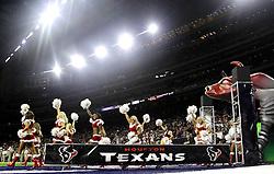 Houston Texans cheerleaders walk onto the field before an NFL football game against the Cincinnati Bengals Saturday, Dec. 24, 2016, in Houston. (AP Photo/Sam Craft)