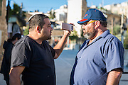 Jewish settler Ofer Yohanna (left) tries to antagonise the Israeli founder of Breaking the Silence Yehudi Shaul in the West Bank city of Hebron.