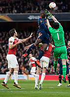 Football - 2018 / 2019 UEFA Europa League - Semi-Final, First Leg: Arsenal vs. Valencia CF<br /> <br /> Petr Cech (Arsenal FC) struggles to collect the high ball as Jaume Domenech (Valencia) rises at The Emirates.<br /> <br /> COLORSPORT/DANIEL BEARHAM