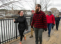Gretchen Gandini and Reuben Bassett walk along the Wow Trail route through Lakeport heading towards Weirs Beach along Paugus Bay on Saturday morning.  (Karen Bobotas/for the Laconia Daily Sun)