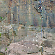 Climber climbing a verticle cliff face