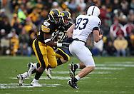 08 NOVEMBER 2008: Iowa linebacker Jeremiha Hunter (42) and Iowa defensive back Brett Greenwood (30) close in on Penn State wide receiver Brett Brackett (83) in the first half of an NCAA college football game against Penn State, at Kinnick Stadium in Iowa City, Iowa on Saturday Nov. 8, 2008. Iowa beat Penn State 24-23.