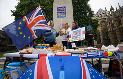 © Licensed to London News Pictures. 12/06/2018. London, UK. Pro EU campaigners selling pies, gather outside the Houses of Parliament in London on the day. The Commons will vote later on whether to give MPs a decisive say on any final deal struck with the EU in the autumn. Photo credit: Ben Cawthra/LNP